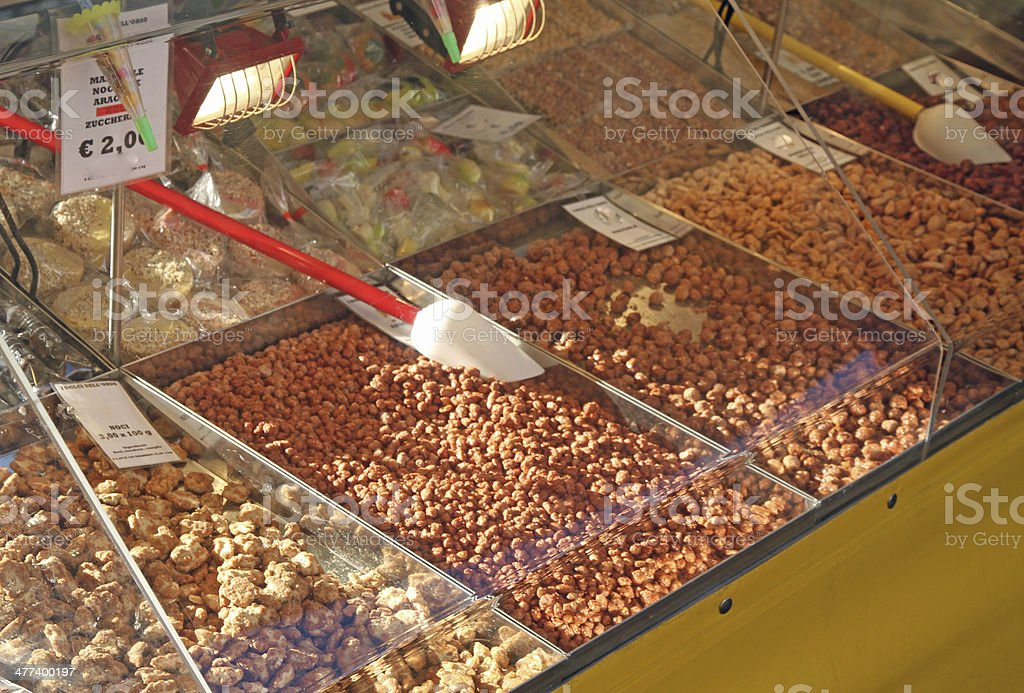 almonds and almond and sugary sweets for sale stock photo