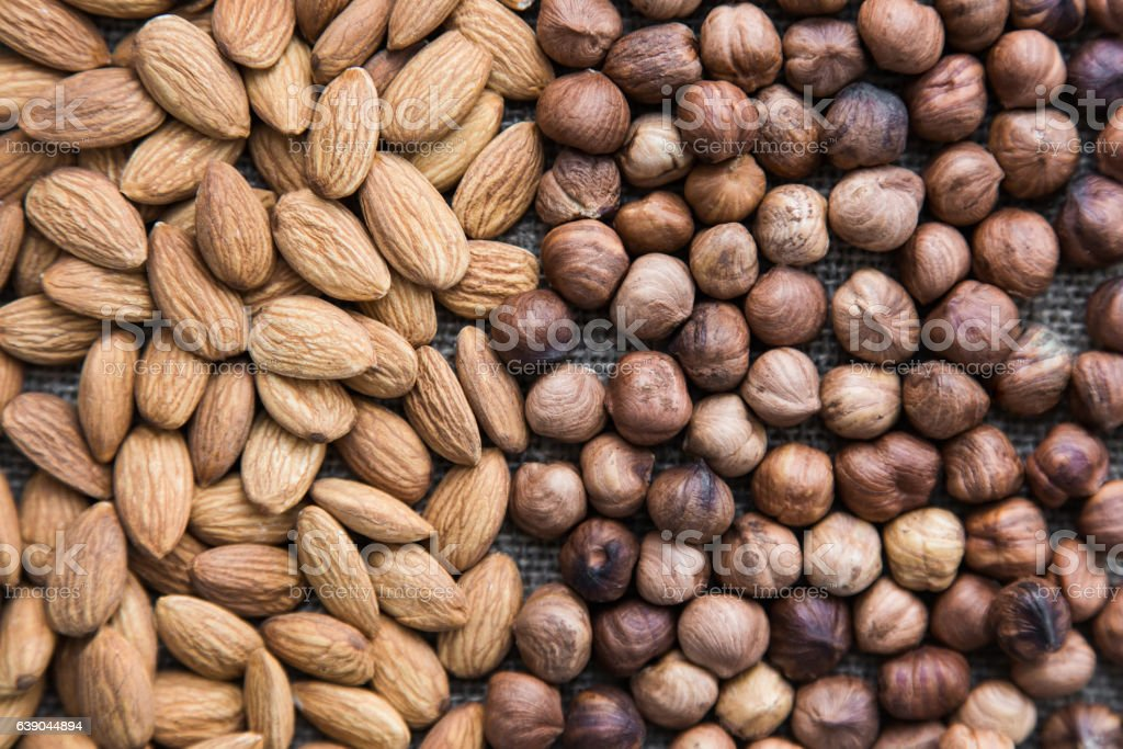 almonds and hazelnuts in full screen stock photo