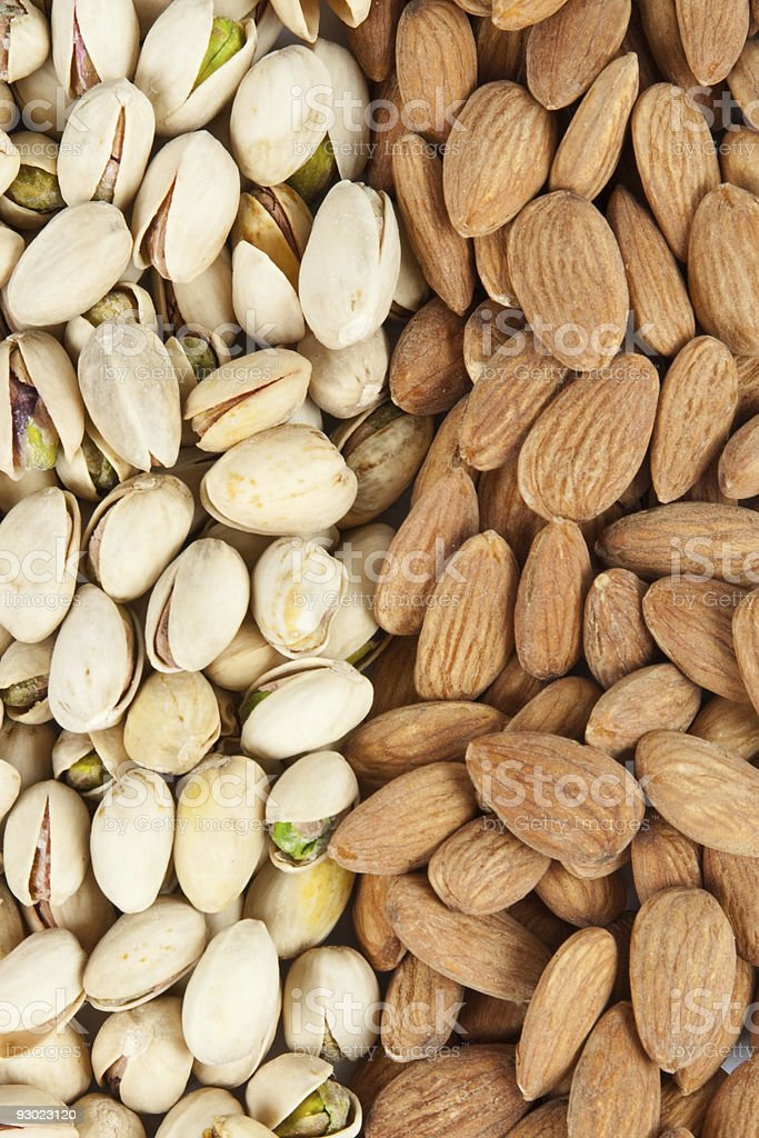 almonds and pistachios background stock photo