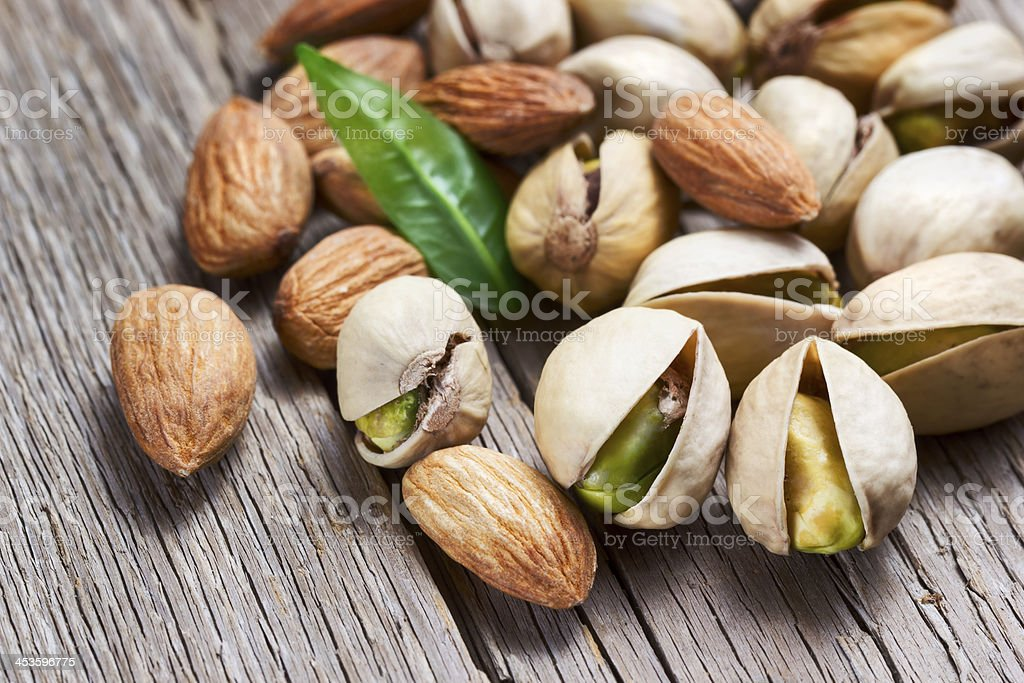 Almonds and pistachios with leaf stock photo