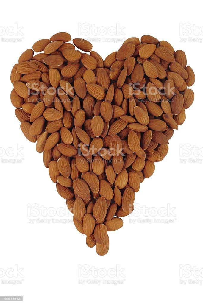Almonds arranged in shape of a heart stock photo
