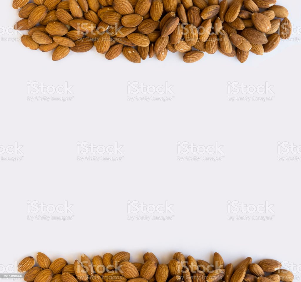 Almonds at border of image with copy space for text. stock photo