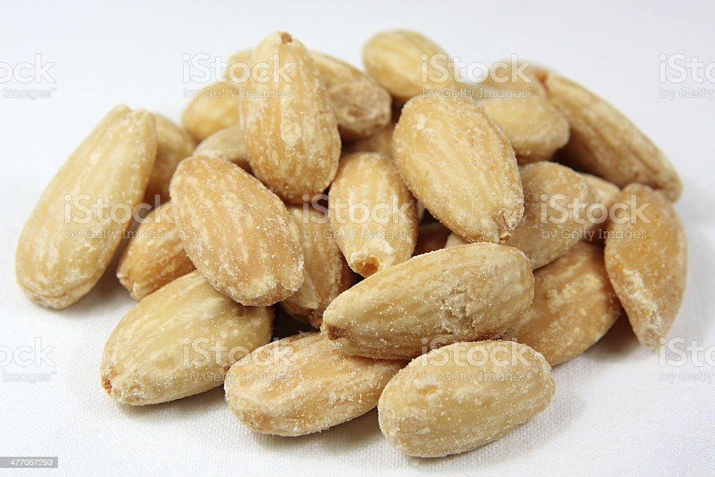 Almonds heap against white background royalty-free stock photo