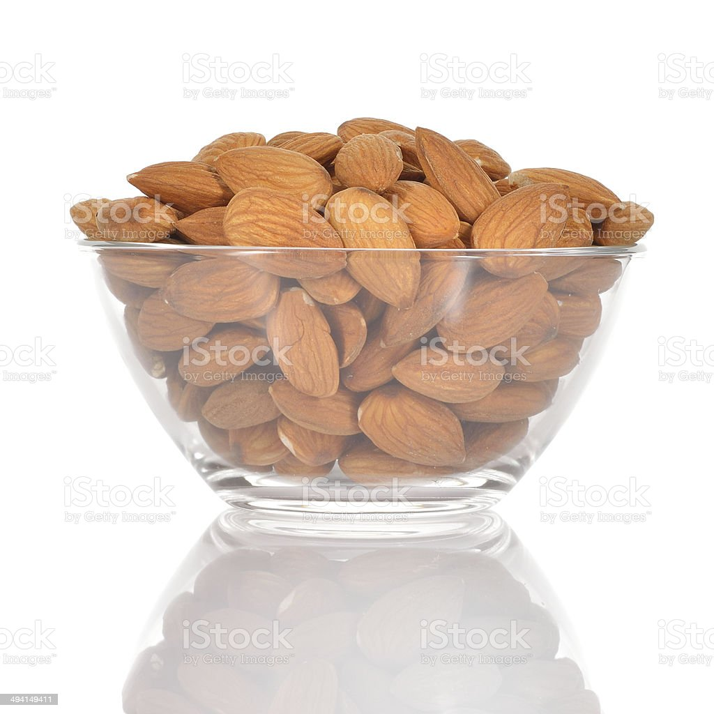 Almonds in a glass bowl on white background. royalty-free stock photo