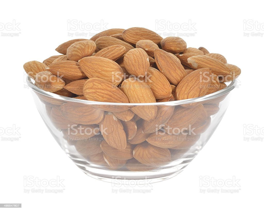 Almonds in a glass bowl on white background royalty-free stock photo
