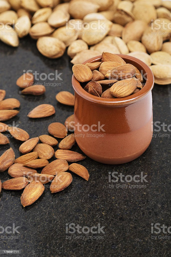 Almonds in a vessel, snacks of nuts royalty-free stock photo