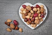 Almonds in a white heart shape plate