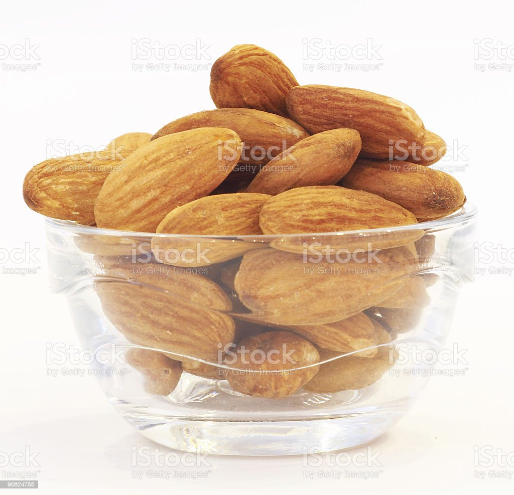 Almonds in glass bowl royalty-free stock photo