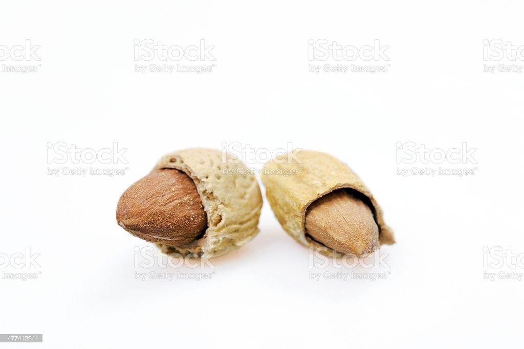 almonds in nutshells royalty-free stock photo