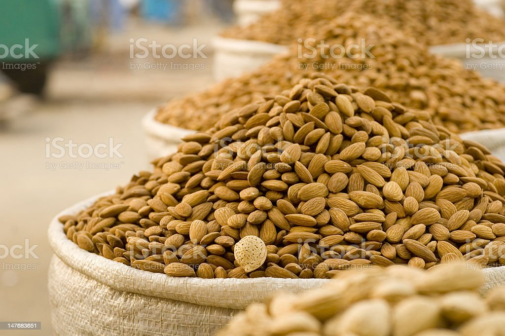 Almonds in sacs at the market royalty-free stock photo