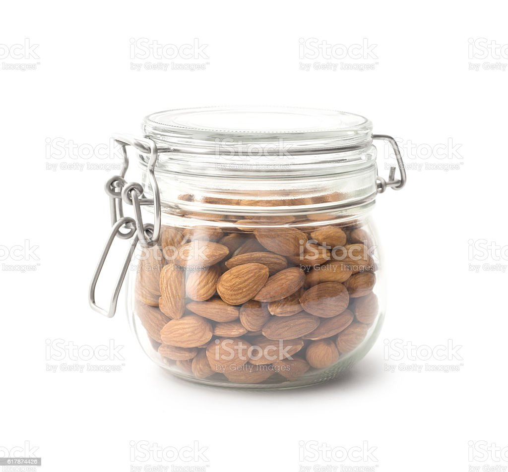 Almonds in the glass jar stock photo