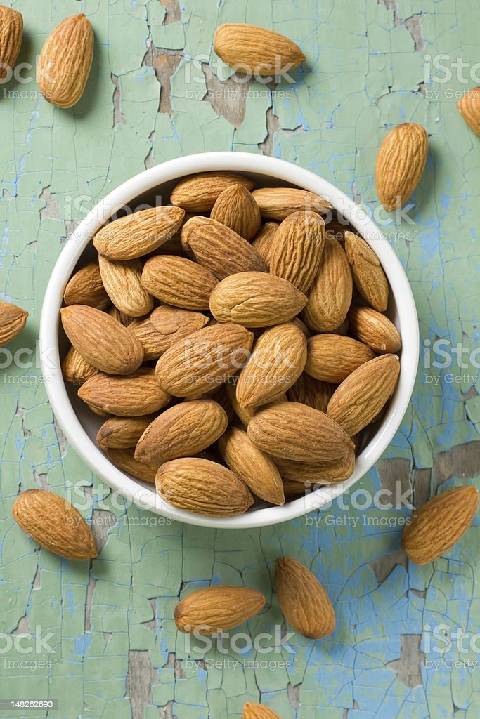 Almonds in the white bowl on vintage wood royalty-free stock photo