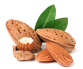 almonds in their skins and peeled with leaf isolated on