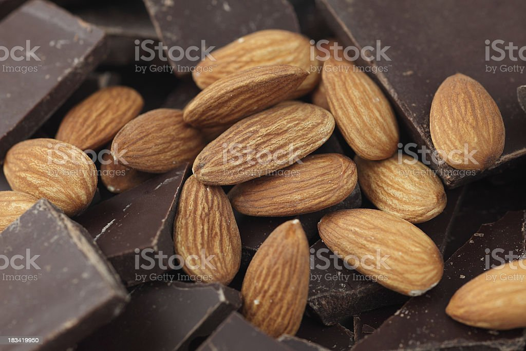 Almonds on chocolate pieces stock photo