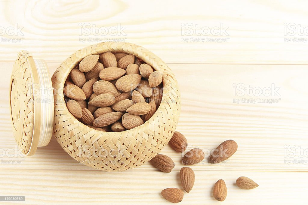 almonds on wooden background royalty-free stock photo