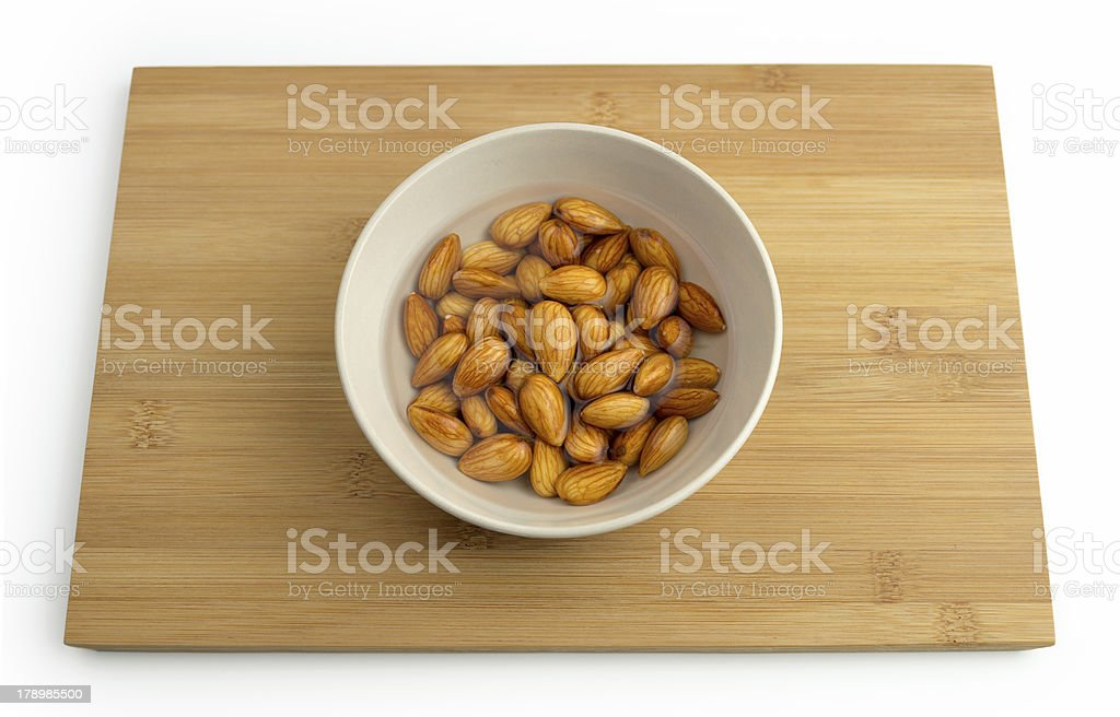 Almonds soaking in a bowl of water royalty-free stock photo