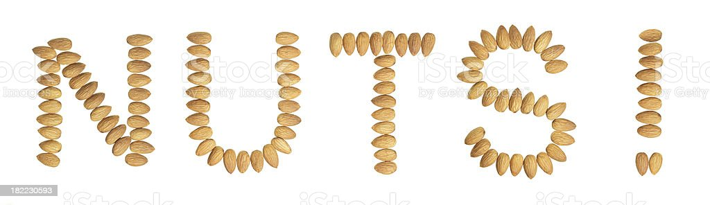 Almonds spell the word NUTS royalty-free stock photo