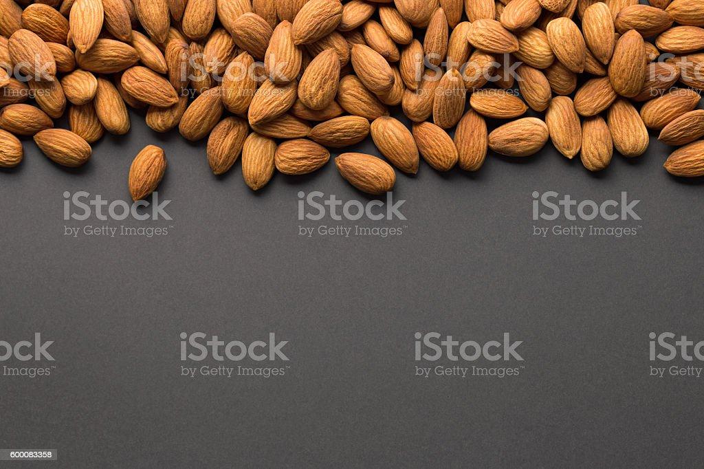 Almonds with dark copy space stock photo