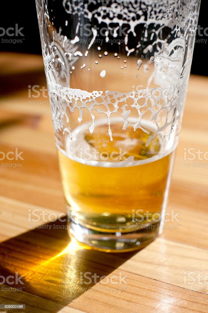 almost empty beer glass stock photo