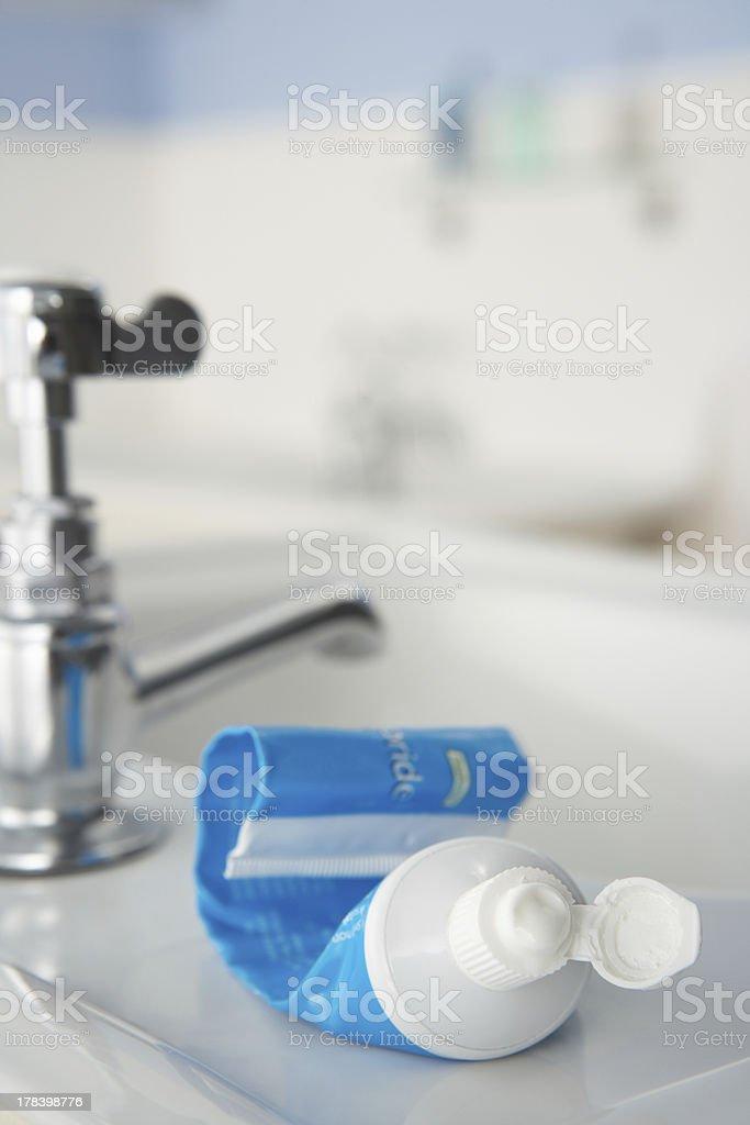 Almost empty toothpaste tube stock photo