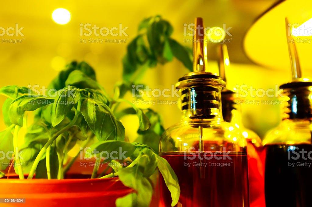 Almost fresh Holy Basil, Olive Oil and Balsamic Vinegar Bottles stock photo
