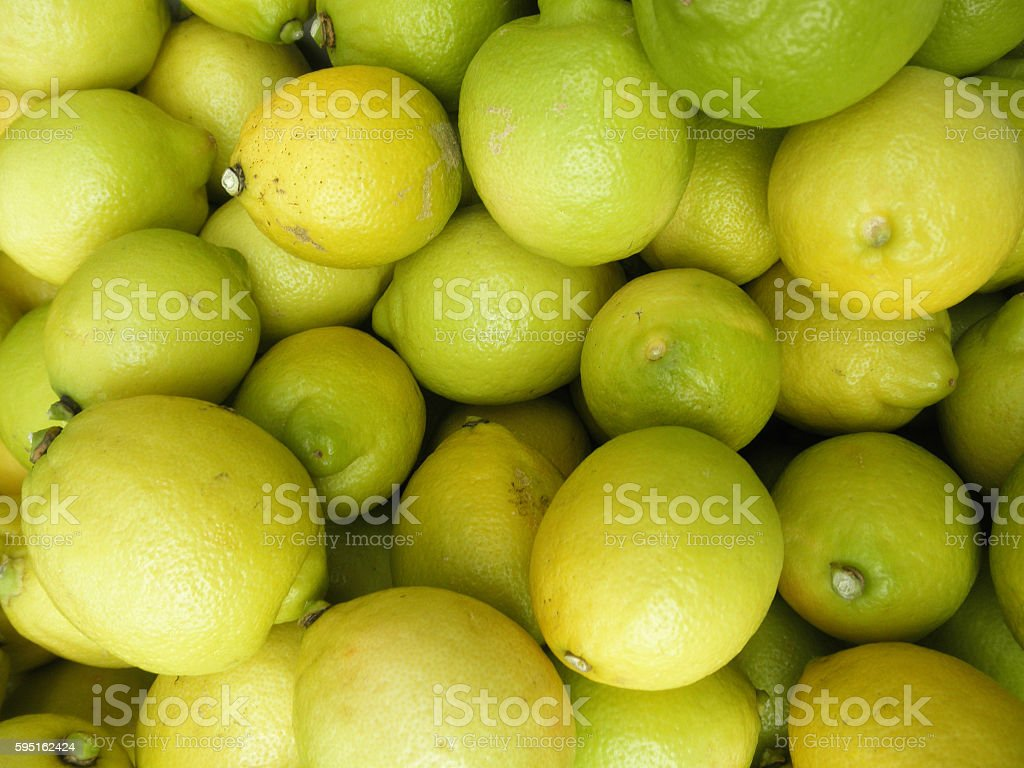 Almost ripe Lemons for sale at market stock photo