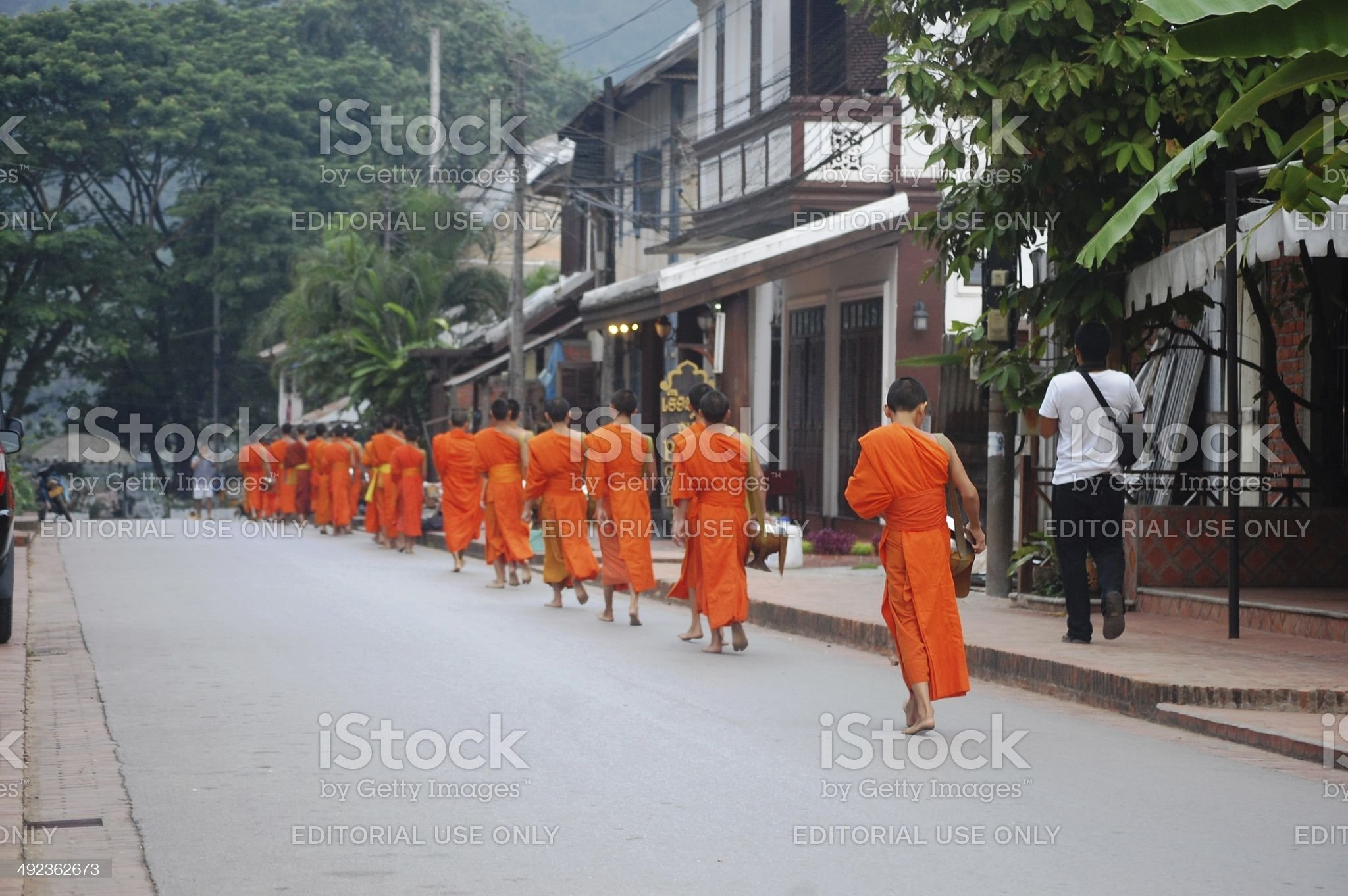 Almsgiving to put sticky rice at Luang Prabang City Loas royalty-free stock photo