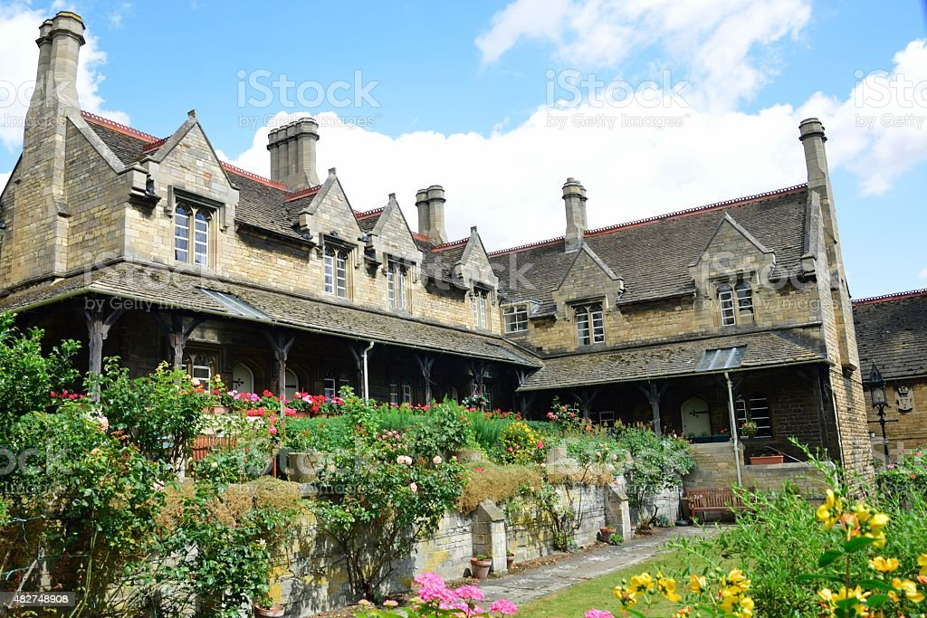 Almshouses in grounds of old hospital stock photo