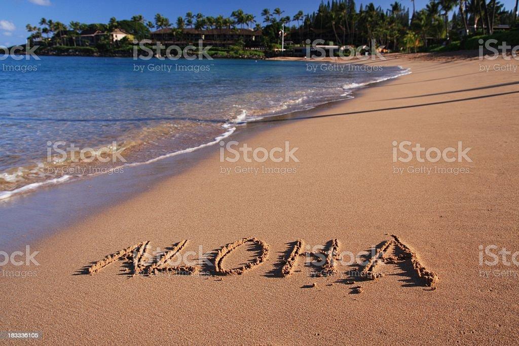 Aloha written in Maui Hawaii resort hotel sand beach stock photo