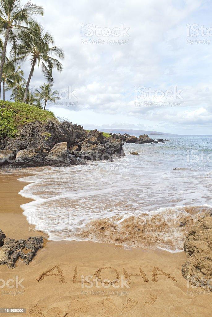 Aloha written in sand on south Maui beach, Hawaii stock photo