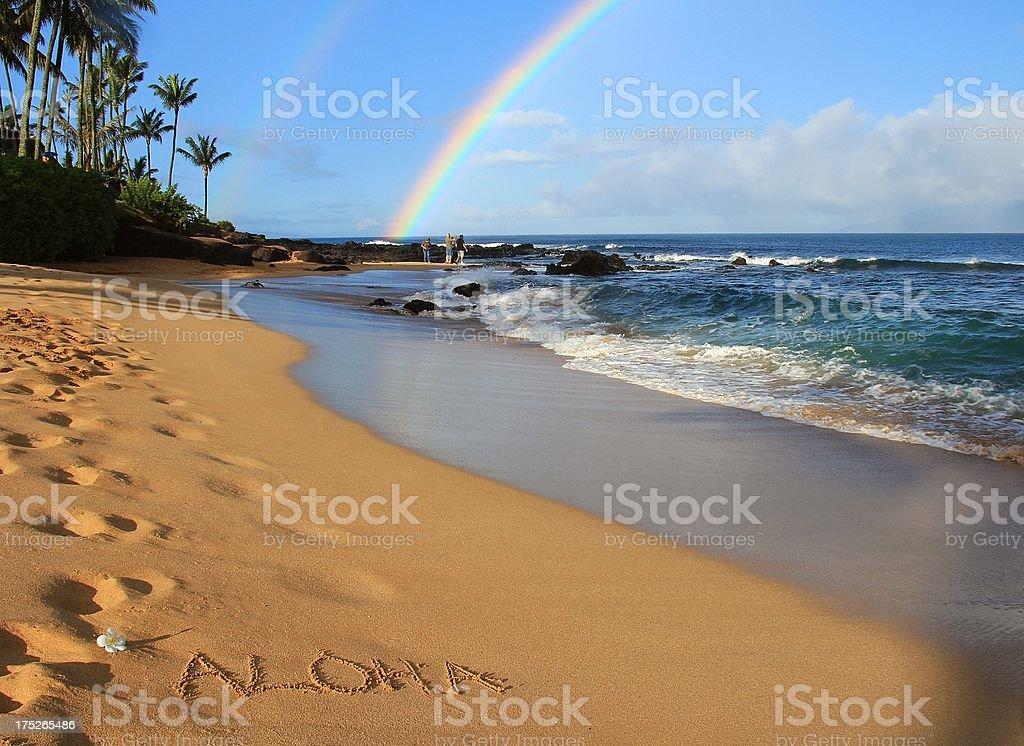 Aloha written on Maui Hawaii beach sand with rainbow royalty-free stock photo