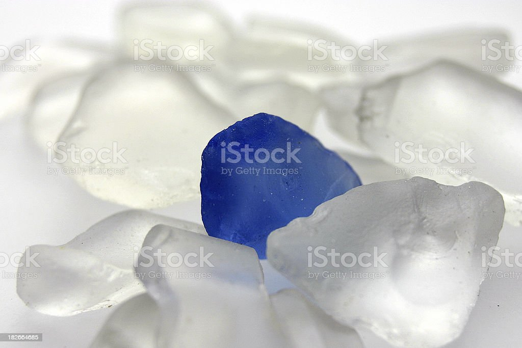 alone blue crystal glass - icy background stock photo