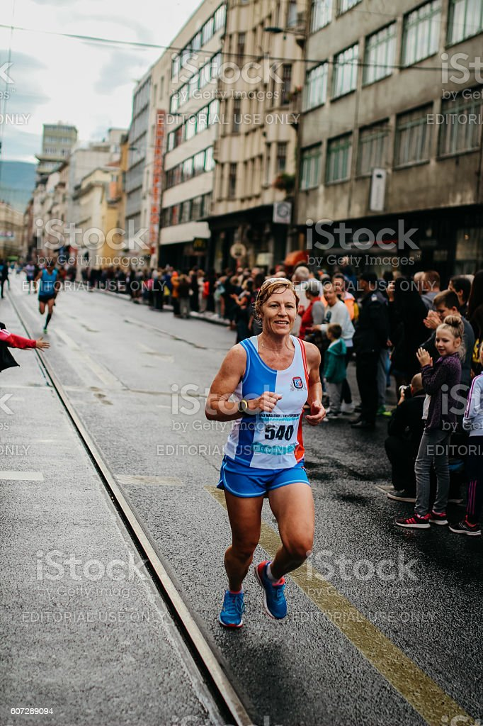 Alone Female Runner is smiling stock photo
