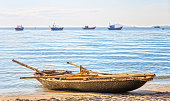 Alone fishing boat beachside in the morning