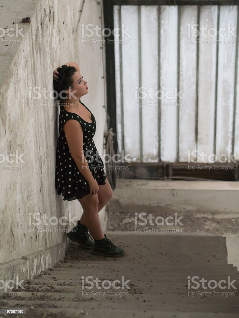 alone girl on the stairs stock photo