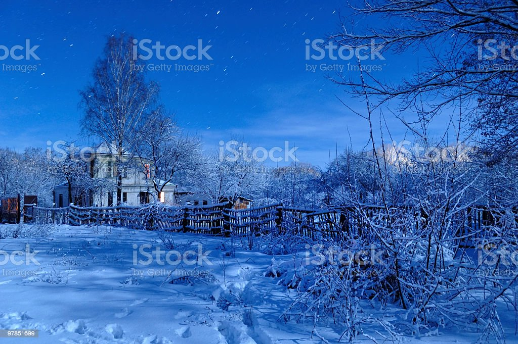 Alone house with snow and stars royalty-free stock photo