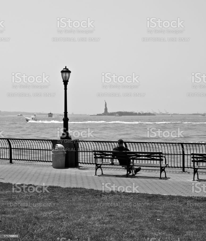 Alone in The City, man looking at harbor, Manhattan, NYC royalty-free stock photo