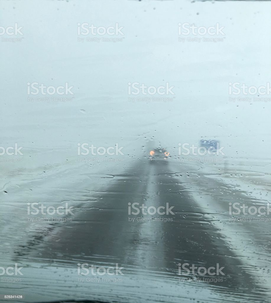Alone On The Highway In Midwest Blizzard stock photo
