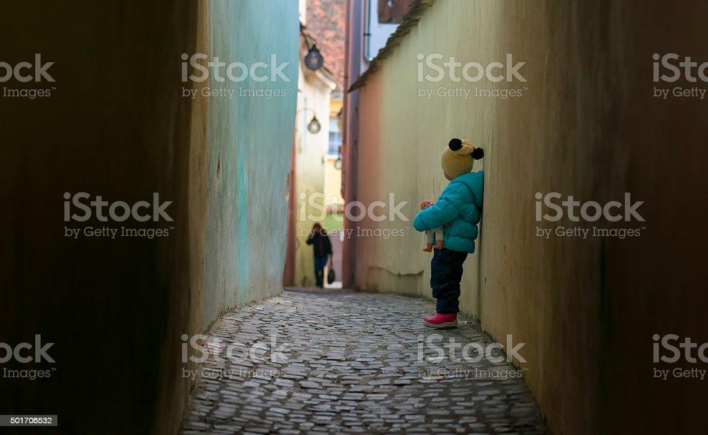 Alone sad child lost on a street stock photo
