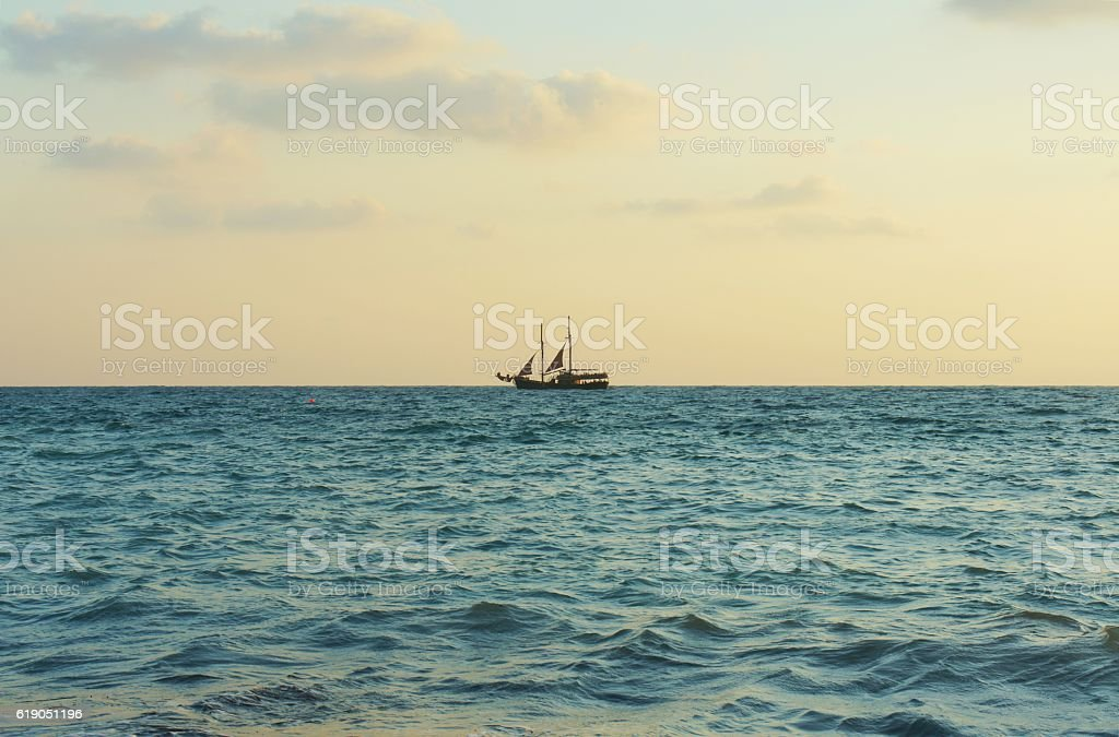 Alone sailboat stock photo