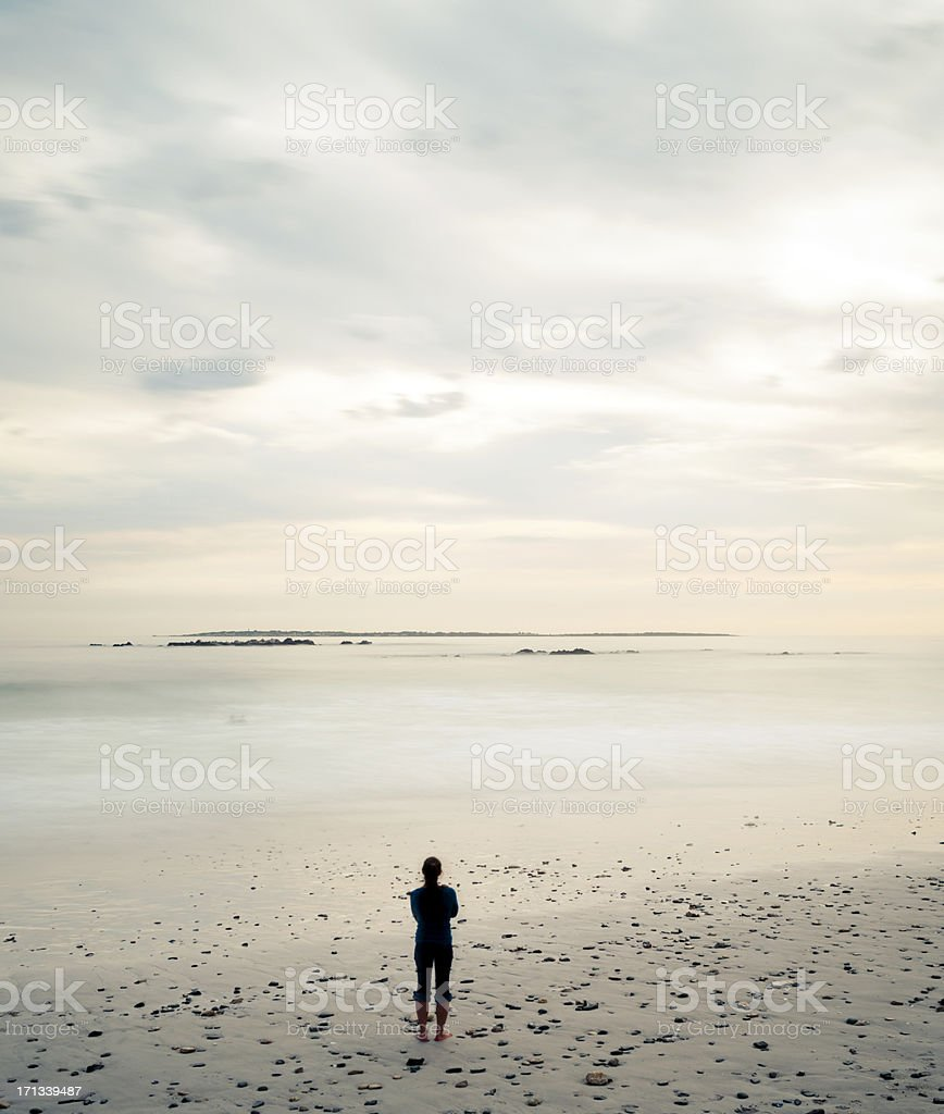 Alone staring over the ocean stock photo