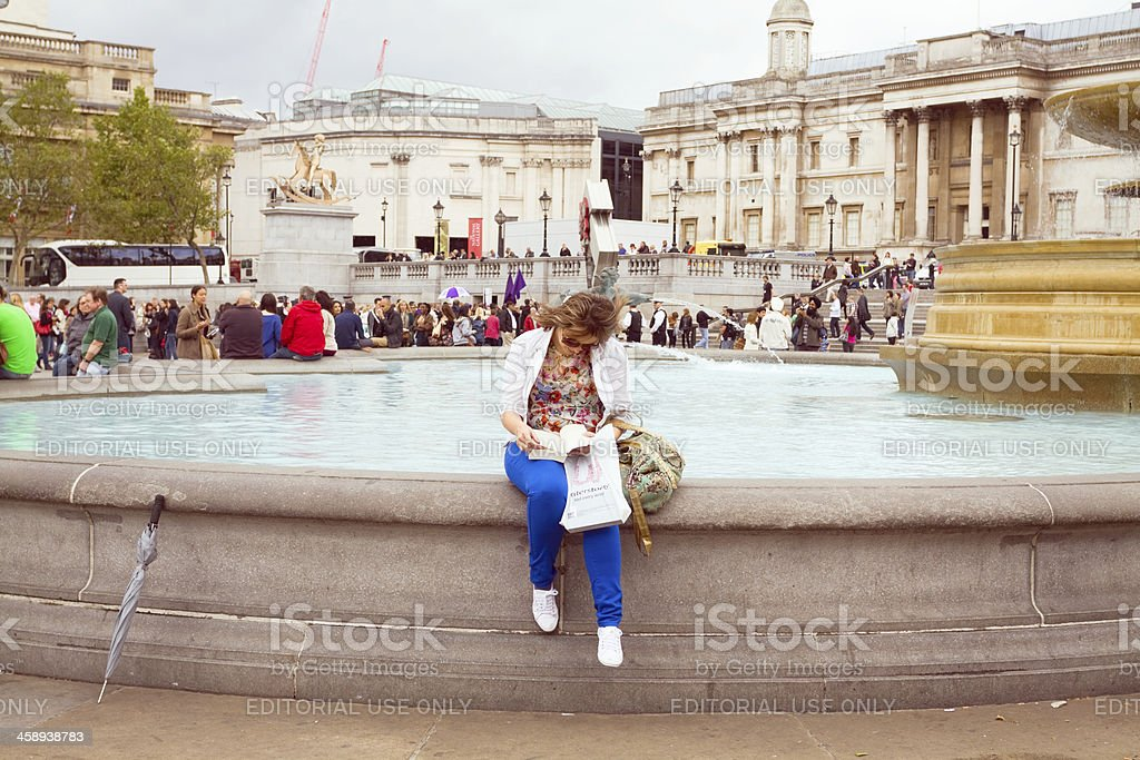 Alone with book in city stock photo