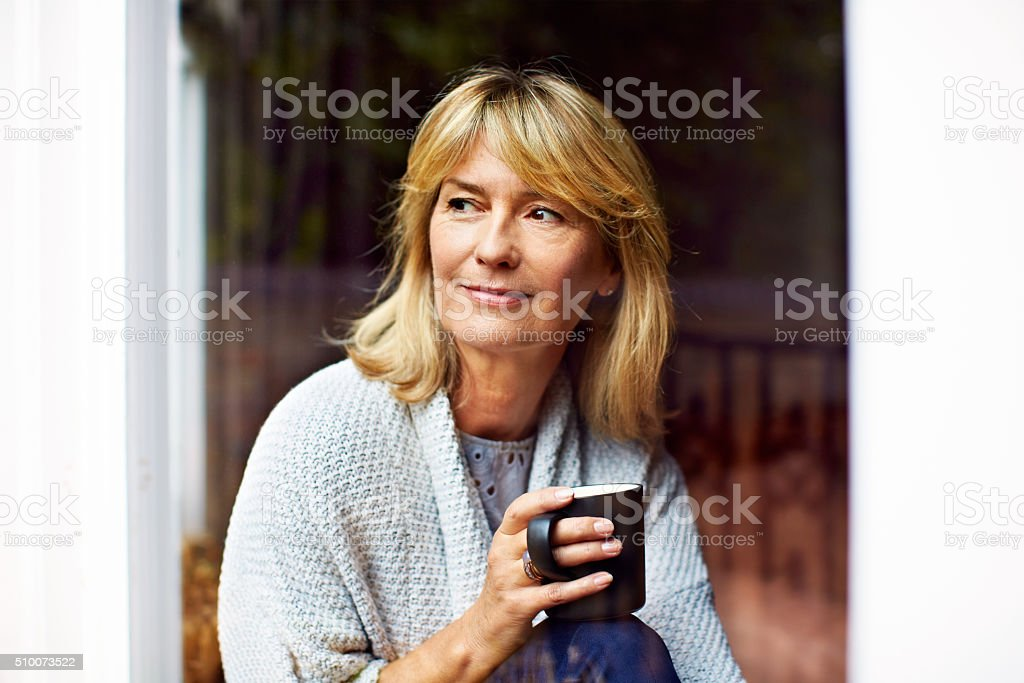 Alone with her thoughts and coffee stock photo
