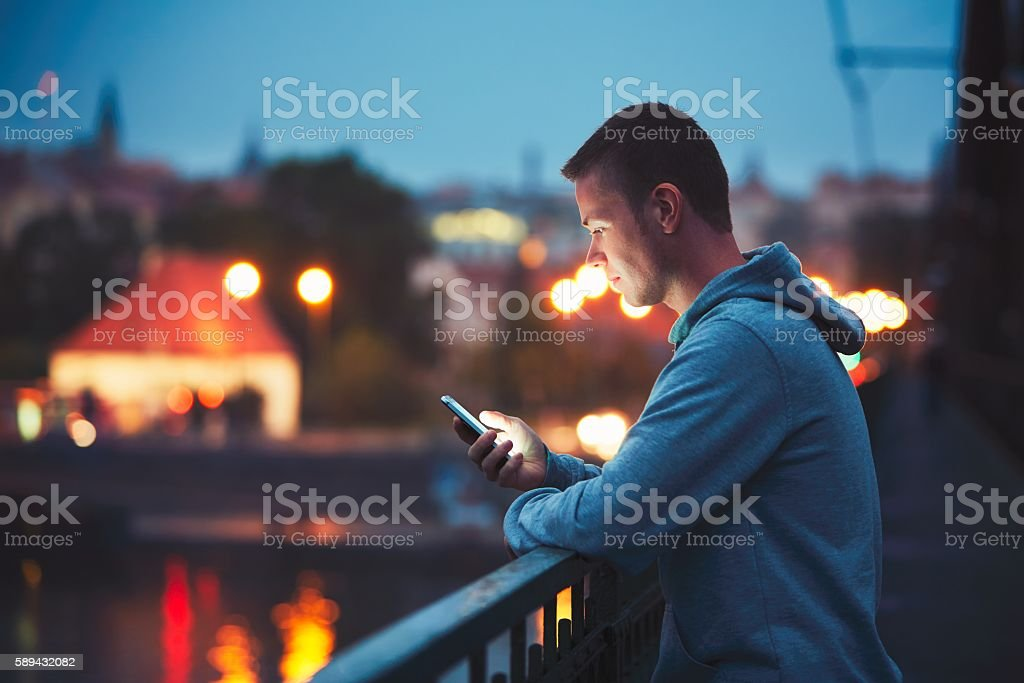 Alone with mobile phone stock photo