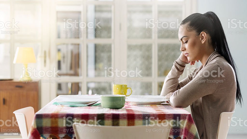 Alone woman sitting and waiting someone stock photo