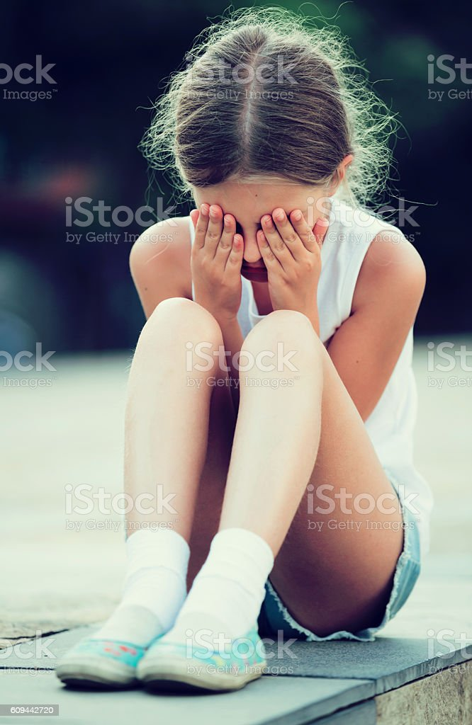 alone worried girl stock photo
