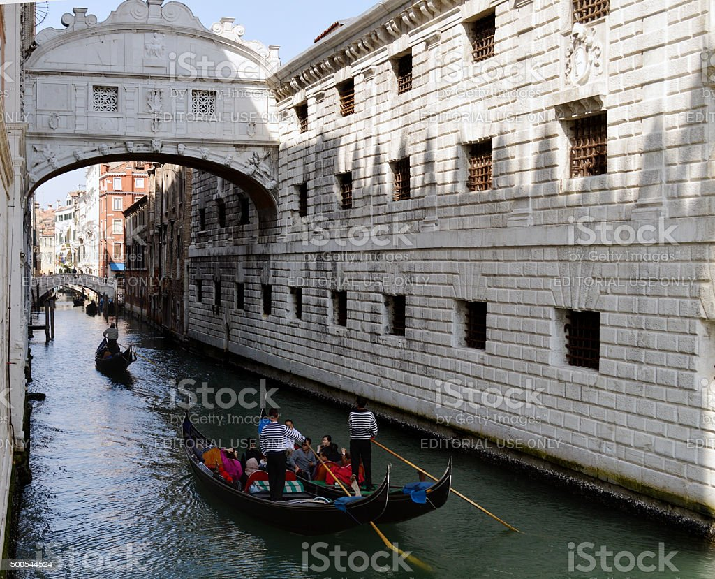 Along the reflections of the famous 'Ponte dei Sospiri' stock photo