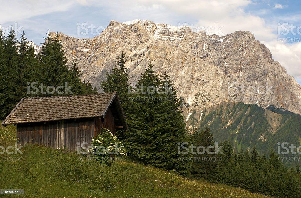 alp hut beneath Mt Wetterstein royalty-free stock photo