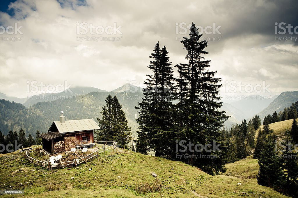 alp hut in the ammergauer alps, bavaria,- vintage filtered stock photo