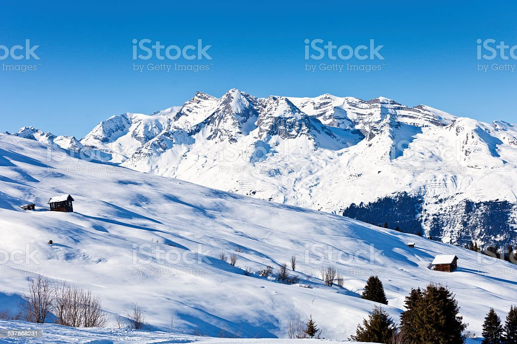 Alp near Obersaxen in Winter stock photo